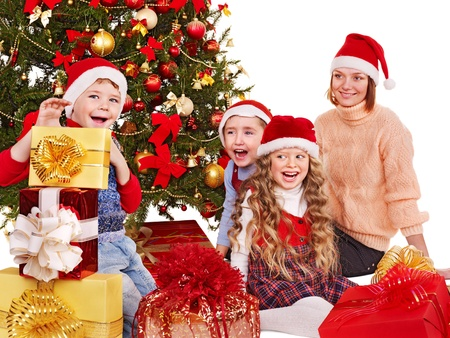 Children with gift box near Christmas tree. Isolated. Stock Photo - 11439385