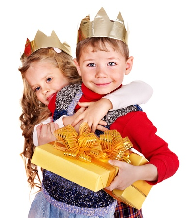 king and queen: Children with gift box near Christmas tree. Isolated. Stock Photo
