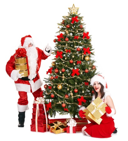 Girl and Santa Clause by Christmas tree. Isolated. photo