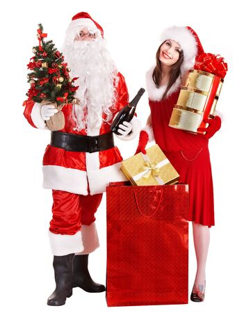 Santa Claus and Christmas girl with shopping bag. Isolated. photo