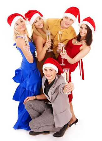 Group young people in Santa hat drinking champagne. photo