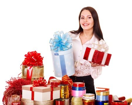 Girl with group of color gift box. Isolated. photo