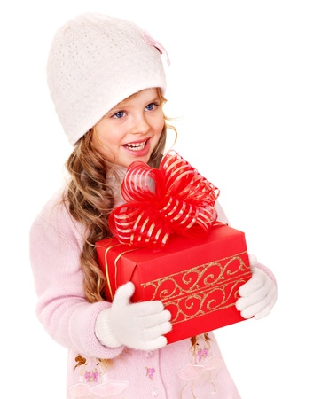 red gift box: Child wearing in hat and mittens holding red  gift box. Isolated.