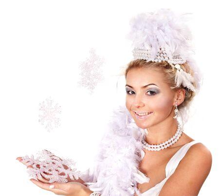 Young beautiful woman holding snowflake. Fashion studio shot. photo