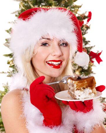 cioccolato natale: Christmas girl il cappello di Babbo e la torta sul piatto. Isolato.