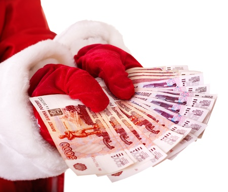 christmas debt: Santa Claus hand with  money (Russian rouble). Isolated.