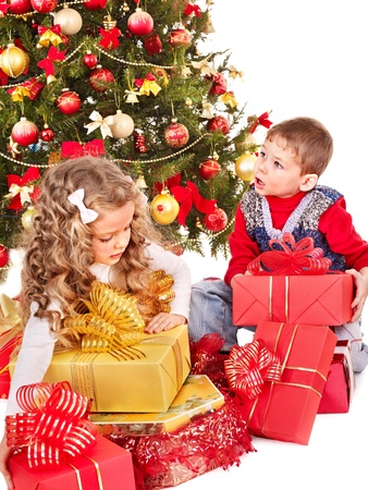 Children with gift box near Christmas tree. Isolated. photo