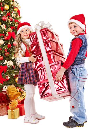 Children in Santa hat with gift box near Christmas tree. Isolated. Stock Photo - 11439568