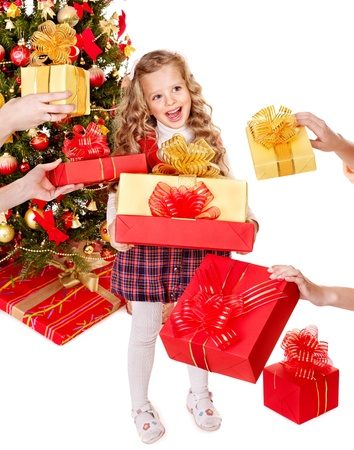 Child with gift box near Christmas tree.Isolated. photo
