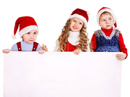 Children in Santa hat with banner. Isolated. Stock Photo - 11439506