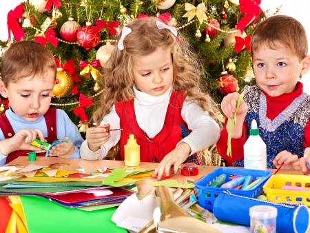 xmas crafts: Children boy and girl making decoration for Christmas.