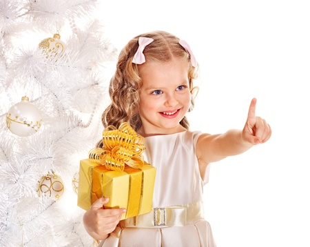 Child with gift box near white Christmas tree. Isolated. Stock Photo - 11439580