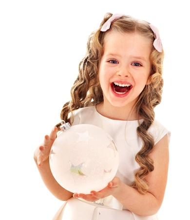curly hair child: Child holding big white Christmas ball.  Isolated. Stock Photo