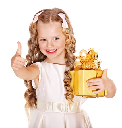 Child with gold gift box on birthday.  Isolated. photo
