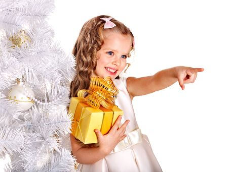Child with gift box near white Christmas tree. Isolated. Stock Photo - 11439561