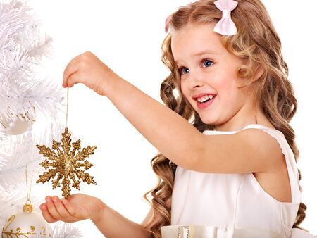 Child holding snowflake to decorate Christmas tree . Isolated. photo