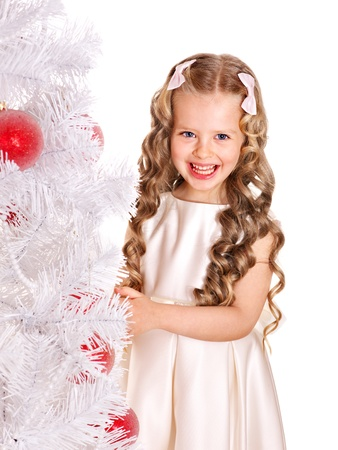 Child decorate white Christmas tree. Isolated. photo