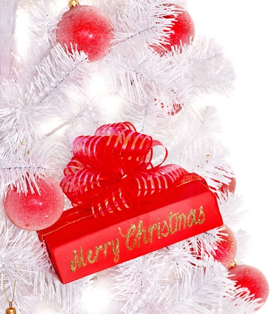 White Christmas tree and red gift box. photo