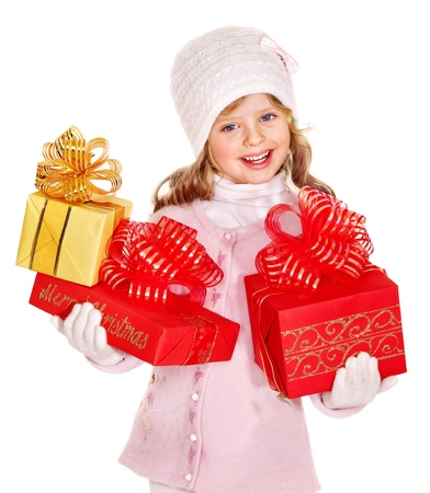 Child wearing in hat and mittens holding red  gift box. Isolated. photo