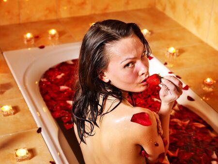 Woman swimming of bath tub. photo