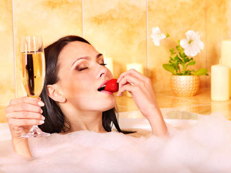 Woman washing in bubble bath. Stock Photo - 11978690