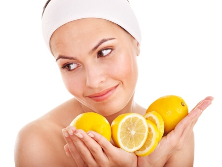 organic lemon: Natural homemade fruit  facial masks . Isolated. Stock Photo