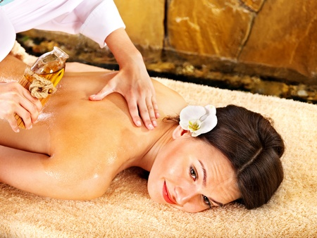 Young woman getting massage in spa. photo