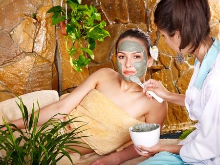 Beautiful girl having clay body mask apply by beautician. Stock Photo - 11978774