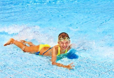 wet suit: Little girl in swimming pool. Summer outdoor.