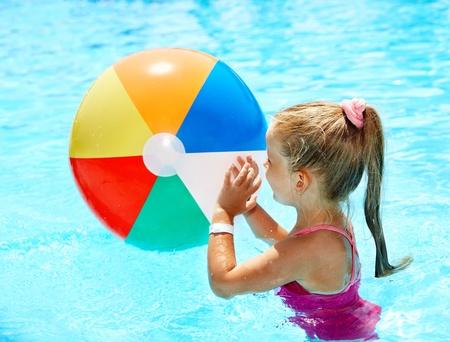 ball aqua: Little girl  swimming in pool. Stock Photo