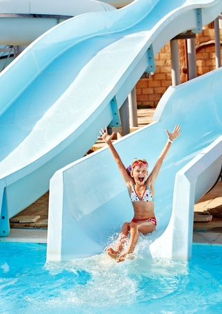 bikini pool: Child on water slide at aquapark. Summer holiday.