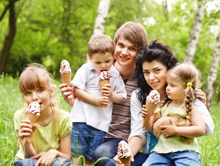 happy family nature: Outdoor family with three kids on green grass. Stock Photo