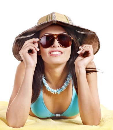 Girl in bikini and sunglasses on beach. Isolated. photo