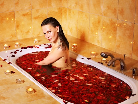 Woman relaxing in bath with rose petal. Stock Photo - 12340921