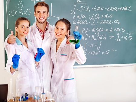 Group chemistry student with flask in classroom. Stock Photo - 12340883