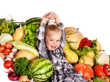 Little girl with vegetable . Healthy eating. photo