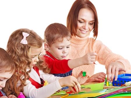 kindergarden: Kindergarden teacher with group children. Isolated on white.