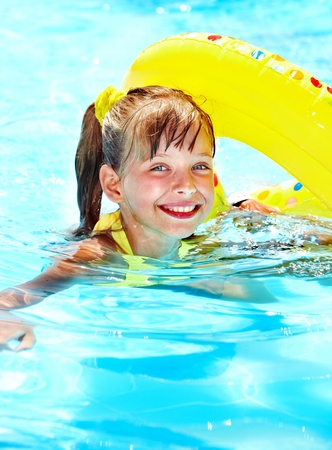 Little girl in swimming pool. Summer outdoor. Stock Photo - 12341014