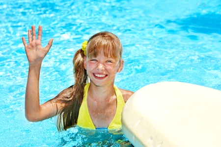Child in swimming pool. Water sport.