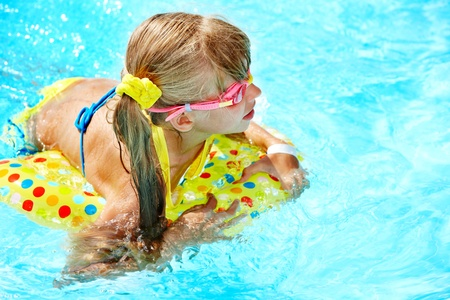 Little girl in swimming pool. Summer outdoor. Stock Photo - 12341024