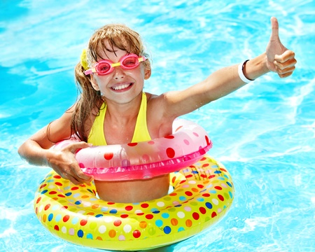 Little girl in swimming pool. Summer outdoor. Stock Photo - 12341234