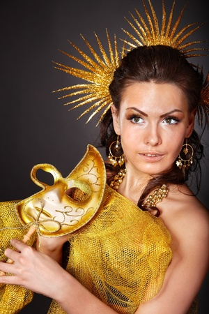 sexy costume: Beautiful young woman  in carnival costume with gold mask.
