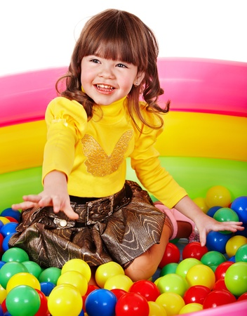 Happy child in group colourful ball. Isolated. photo