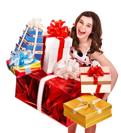 Beautiful girl with stack of gift box. Isolated. photo