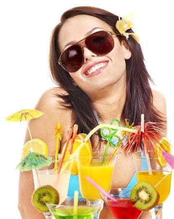 Girl in bikini on beach drinking cocktail. Isolated. photo