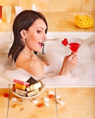 Woman washing in bubble bath. photo