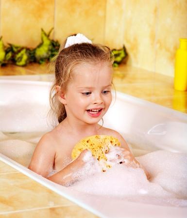 soap sud: Child washing in bubble bath . Stock Photo