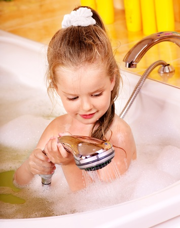 Little girl washing in bubble bath . Stock Photo - 12341173