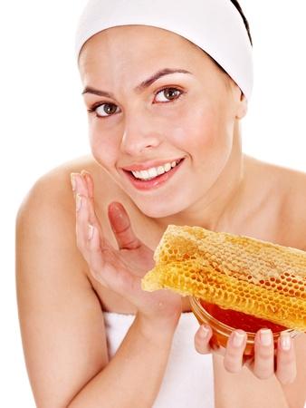 making face: Natural homemade organic  facial masks of honey. Isolated.