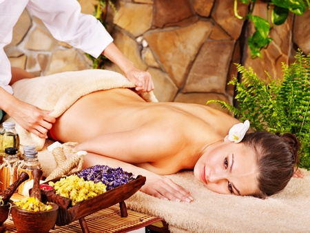 cosmetician: Beautiful young woman getting massage in spa. Stock Photo